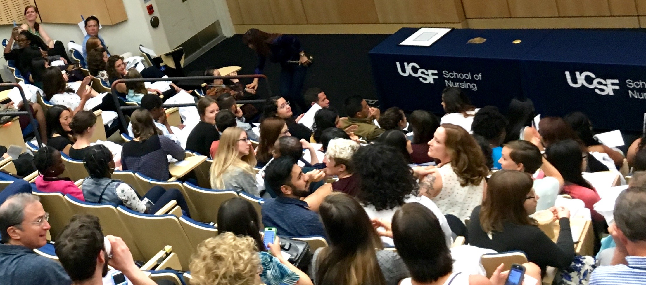 Audience gathers for start of MEPN White Coat Ceremony in UCSF's Cole Hall.
