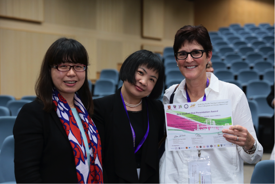 Shantou University's Dr. Su and Lisa Lommel, RN, PhD(c), FNP, MPH, pose after receiving her award for best student oral presentation.