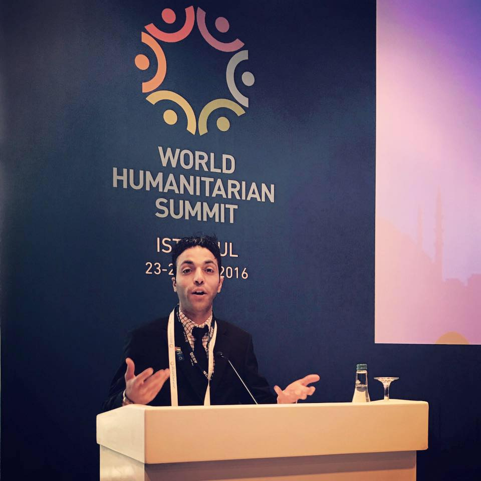 Photo of Hamza Abid, RN, MS(c), Oncology Adult/Gerontology Clinical Nurse Specialist Candidate giving speech at World Humanitarian Summit in Istanbul.