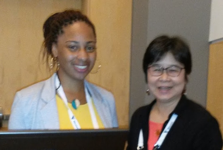 Brianna Singleton and Oi Saeng Hong pose for a photograph at the conference