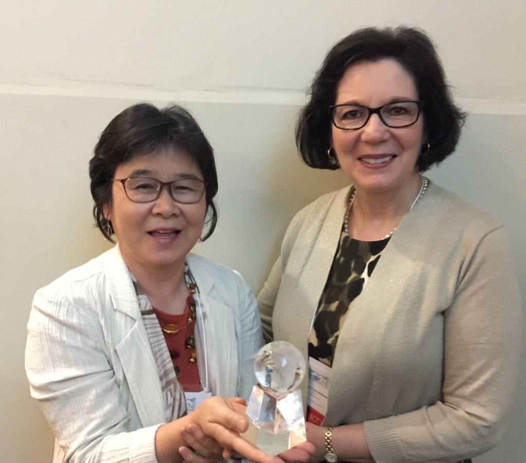 (Left to right) Oi Saeng Hong, RN, PhD, FAAN, and President of Sigma Theta Tau International (STTI) Honor Society of Nursing Cathy Catrambone, PhD, RN, FAAN