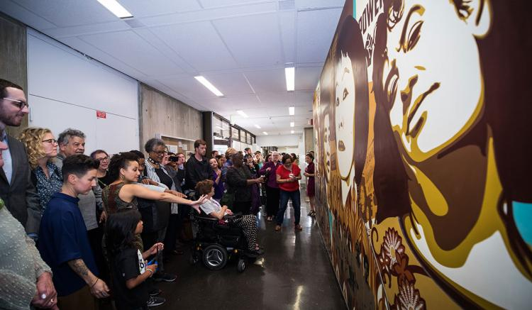 Faculty, students, staff, alumni and special guests celebrate the unveiling of the new mural. (Photography by Elisabeth Fall)