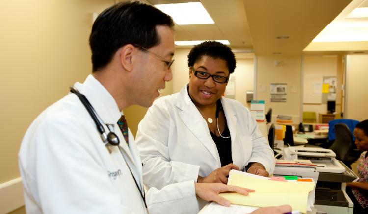 Family nurse practitioner Erica Bagby confers with physician Gregory Wong at San Francisco's South of Market Health Center