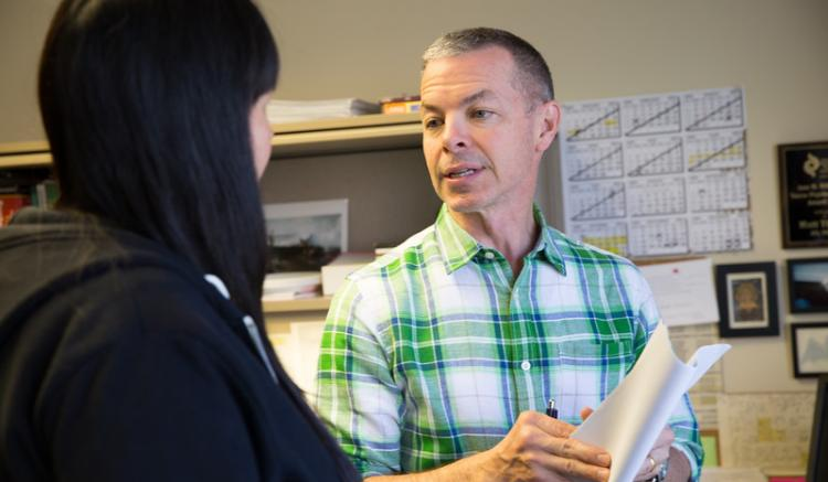 Clinical Professor Matt Tierney speaks with a student